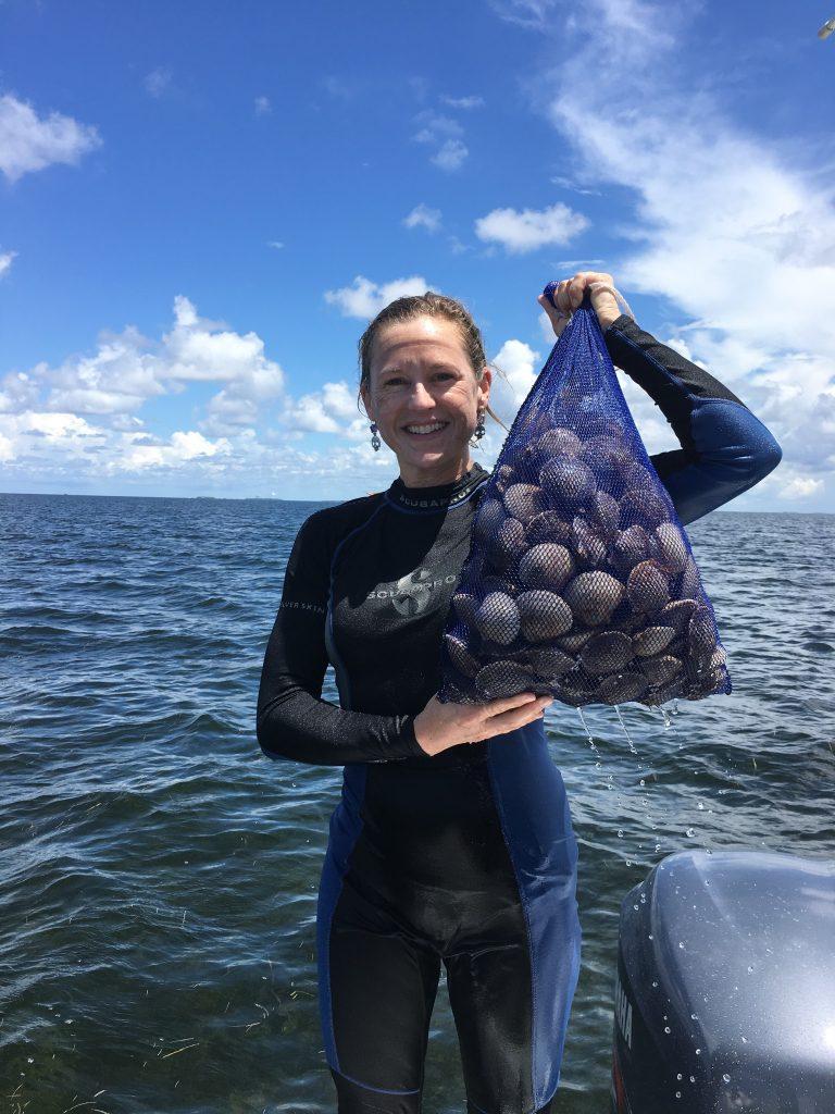 Lindsay with bag of scallops
